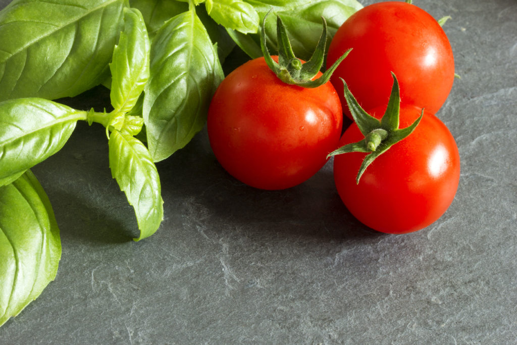 Tomatoes and basil Photo Credit:narloch-liberra (iStock).