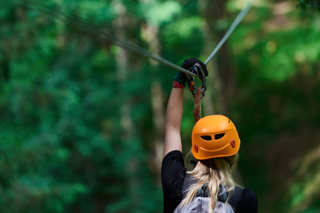 Zip Lining Photo Credit: stock_colors (iStock).