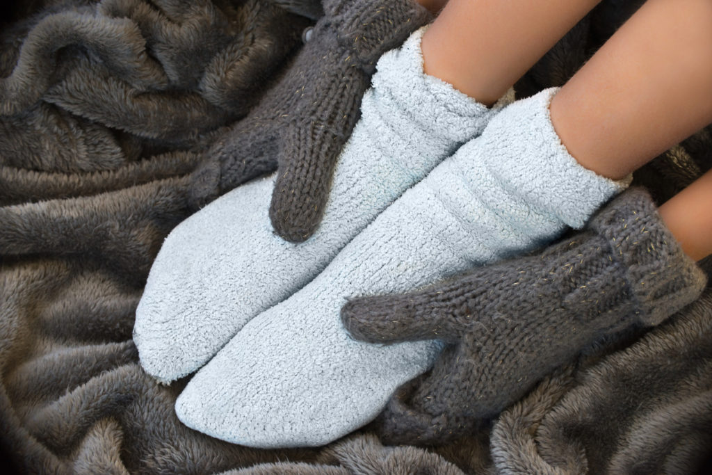 warm socks Photo Credit: Delpixart (iStock).